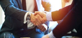 business-people-shaking-hands-finishing-up-a-meeting-picture-id637367232